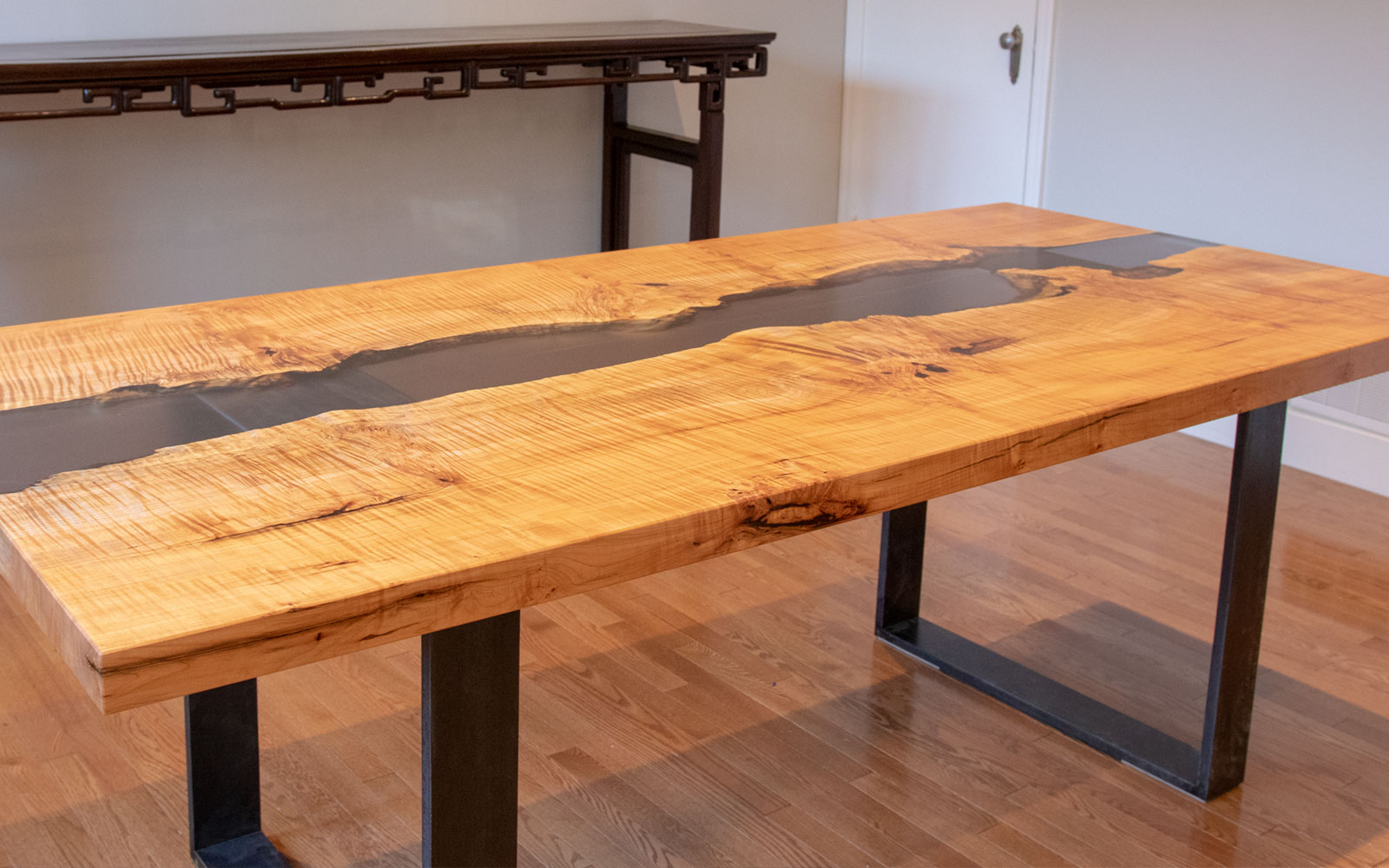 Quilted Maple Dining Table With Tinted Black Resin River | Calgary, AB |  84u201dLx40u201dWx30u201dH | $10,000 CAD